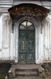 Old door. Old grey wooden door ,entrance with the tumbledown stages Stock Image