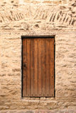 Old door. Old style door in city wall Stock Images