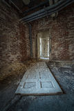 Old Door in an abandoned building. Distressed door on the ground in an abandoned building Royalty Free Stock Photo