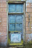 Old door of an abandoned house Royalty Free Stock Image