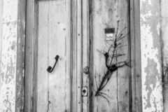 An old door of abandoned house stock photography