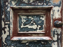 Old door with abraded paint Stock Images
