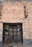Old door and adobe brick wall,Shanxi, China stock photo