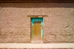 Old door at an adobe house Royalty Free Stock Photography