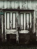 Old door. That is all worn and painted. It& x27;s broken Royalty Free Stock Image