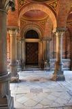 Old Door Among Ancient Columns Stock Image