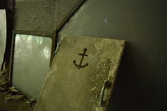 Old door with anchor. An old door with the cut out of an anchor stock photography