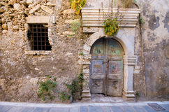 Old door in the ancient wall Royalty Free Stock Photo