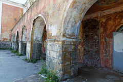 Old door and the arch in the  building. Old door and the arch in the crumbling building Royalty Free Stock Photos