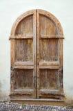 Old door. Old arch wooden door close-up Stock Images