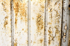 Old door background. Old peel off and oxidize metallic door background Royalty Free Stock Photography