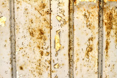Old door background. Old peel off and oxidize metallic door background Royalty Free Stock Photos