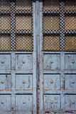 Old door with bars in sunlight Royalty Free Stock Photos