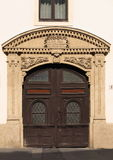 Old door with beautiful stone frame. Old wooden door with beautiful carved stone frame (photo taken in the Castle district, Budapest, Hungary Royalty Free Stock Images