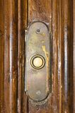 Old door bell button. Old door bell on wooden background Stock Photography