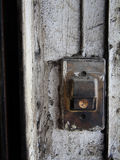 Old Door bell on dirty white wall Royalty Free Stock Photos