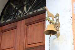 Old door with bell Stock Photography