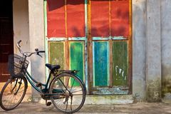 Old door and bicycle Stock Image
