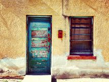 Old door. Blue adobe house Royalty Free Stock Photography