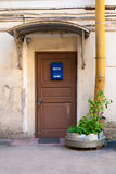 The old door with blue post box. The old door with blue post box in the yard in Saint-Petersburg royalty free stock photography