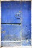 Old door of blue wood divided into three parts and with lock in stock images