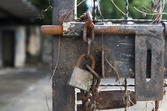 Old door bolt and chain with lock Royalty Free Stock Photography