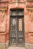 Old door. Of brick building - Georgia Stock Images