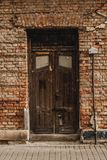 Old Door and Brick Facade royalty free stock photo