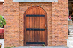 Old door with brick wall stock image