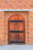 Old door with brick wall Royalty Free Stock Photography