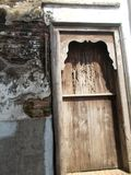 Old door wooden and old brick wall Stock Photos