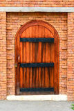 Old door with brick wall Royalty Free Stock Images