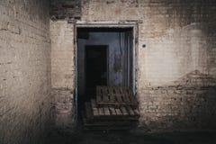 old door on a brick wall Stock Photos