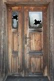 Old door. With broken windows Stock Photography