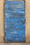 Old door, built up from timber, blue colored. Royalty Free Stock Image