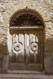 Old door with carved oak wood and iron, architectural detail in royalty free stock photos