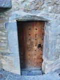 Old Door. Old Castle wooden Door in stone wall with knocker stock illustration