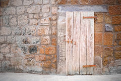 Old door of cellar in the old style of medieval village.  Stock Photo