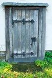 Old door in the church. Old wooden door in the church Stock Photo