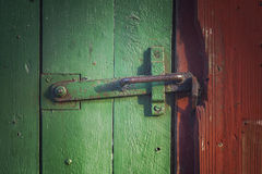 Old door with clasp Stock Images
