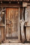 Old door. Close up of a old door of a tradicional commerce in a salt mine village located in Rio Maior - Portugal royalty free stock photography