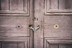 Old door. Old closed wooden gate with chain Royalty Free Stock Image