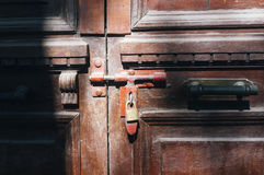 Old door. Old closed wooden door with padlock Stock Photography