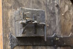 Old door closing mechanism from a fortress stock image