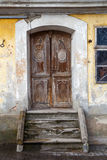 Old door with concrete stairs Stock Images