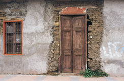 Old door. Old construction in ruins closed unfinished Stock Image