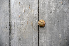 Old door with copper button handle photography Royalty Free Stock Image