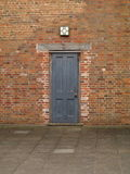 Old Door in the courtyard at Rufford abbey nottingham near sherwood forest UK Royalty Free Stock Images