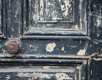 The Old Door with Cracked Paint Background closed with wood palets and vintage wall macro Stock Image