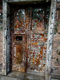 Old door with cracked pilled paint. Old door with cracked multi layer colorful paint in St. Petersburg, Russia Stock Photography